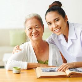staff and elderly woman smiling