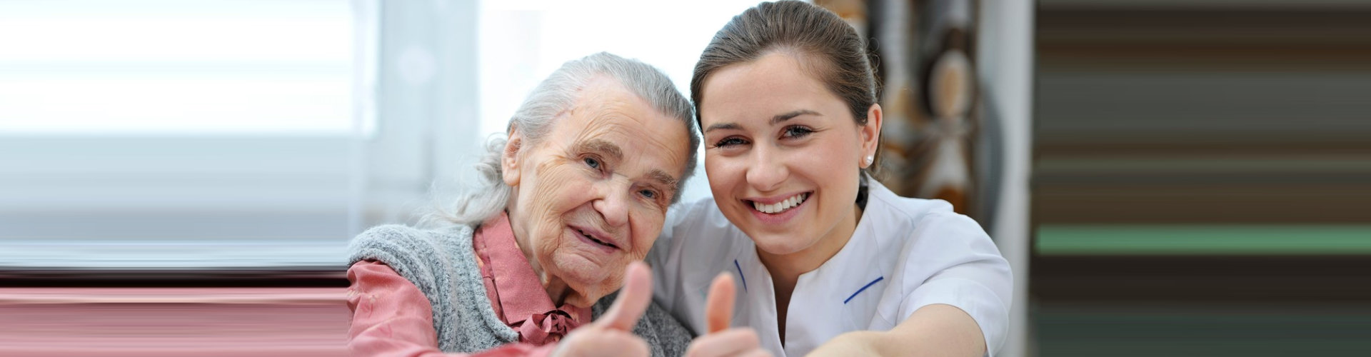 senior woman ang her caregiver