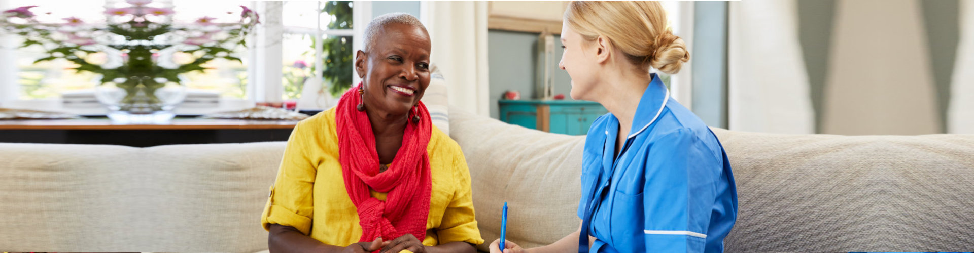 medical social worker counseling senior woman smiling